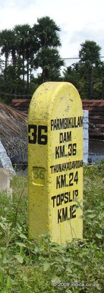 Milestone at the entry point of Indira Gandhi-National Park showing distances to Parambikulam and Top Slip