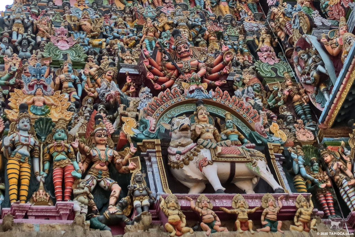 Brightly painted stucco images on the temple towers at Tamilnadu