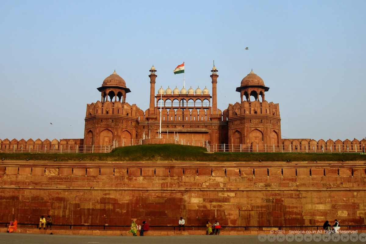 The facade of Red Fort with the India tri-colour flag flying atop.