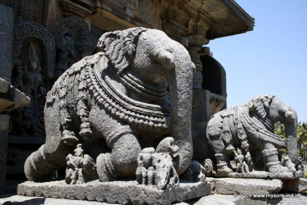 The richly carved elephant balustrades on the porch to the main shrine at Koravangala