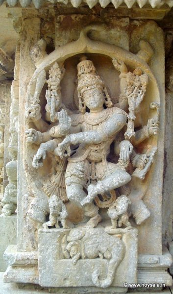 Gajasurasamhara: Shiva dancing inside the skin of the slain elephant. Note the four legs, tail and the head of the elephant.