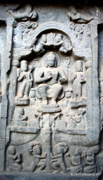 Buddha image on the vestibule wall of Karla Caves